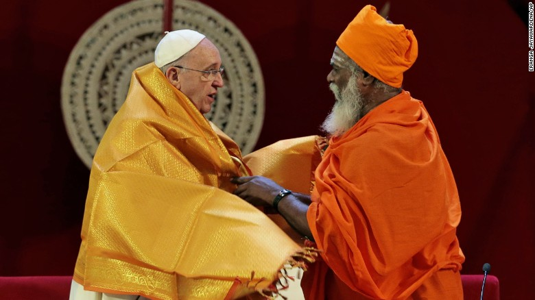 Hindu priest Kurakkal SivaSri T. Mahadeva presents a shawl to Pope Francis in Colombo, Sri Lanka, on Tuesday, January 13.