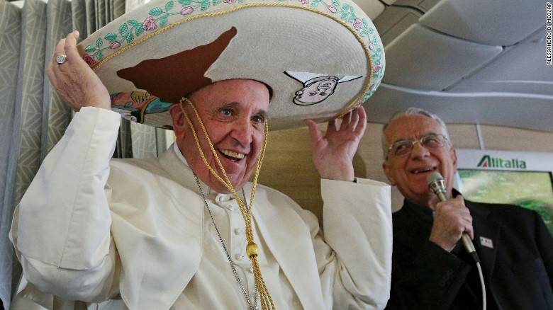 Pope Francis tries on a traditional sombrero he received as a gift from a Mexican journalist on Friday, February 12, aboard a plane during his flight from Rome to Habana, Cuba. The voyage kicks off his week-long trip to Mexico. With his penchant for crowd-pleasing and spontaneous acts of compassion, Pope Francis has earned high praise from fellow Catholics and others since he replaced Pope Benedict XVI in March 2013.